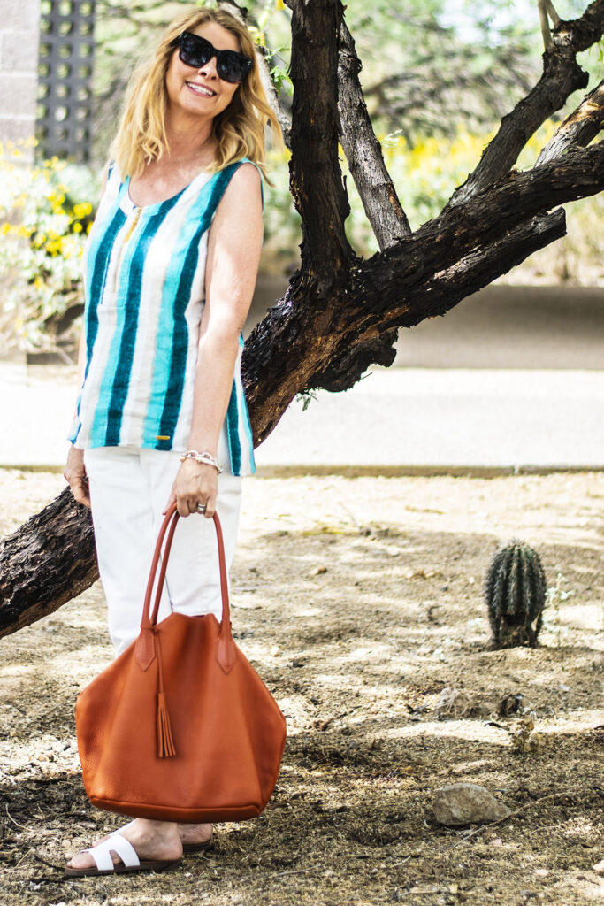Pop of color with an orange purse