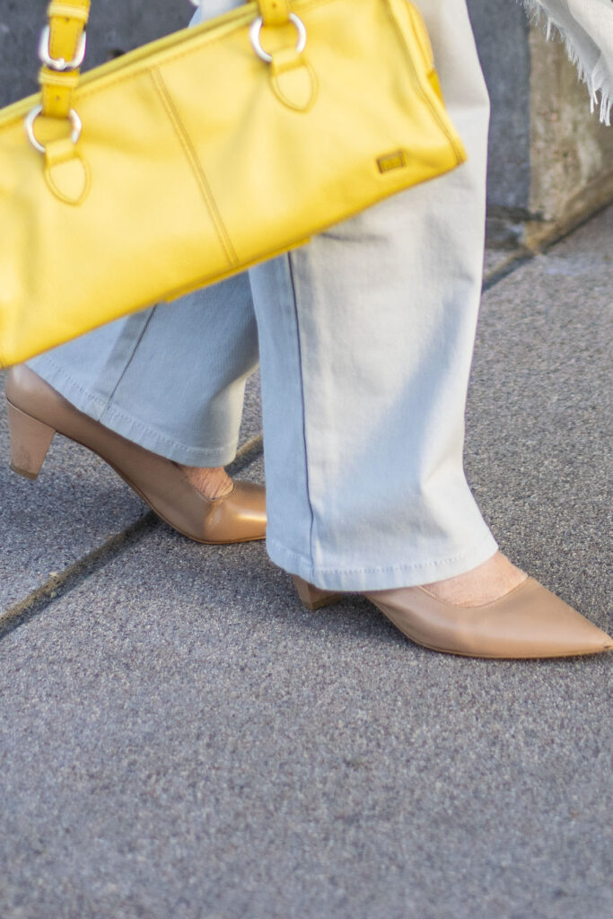 Yellow purse and nude shoes