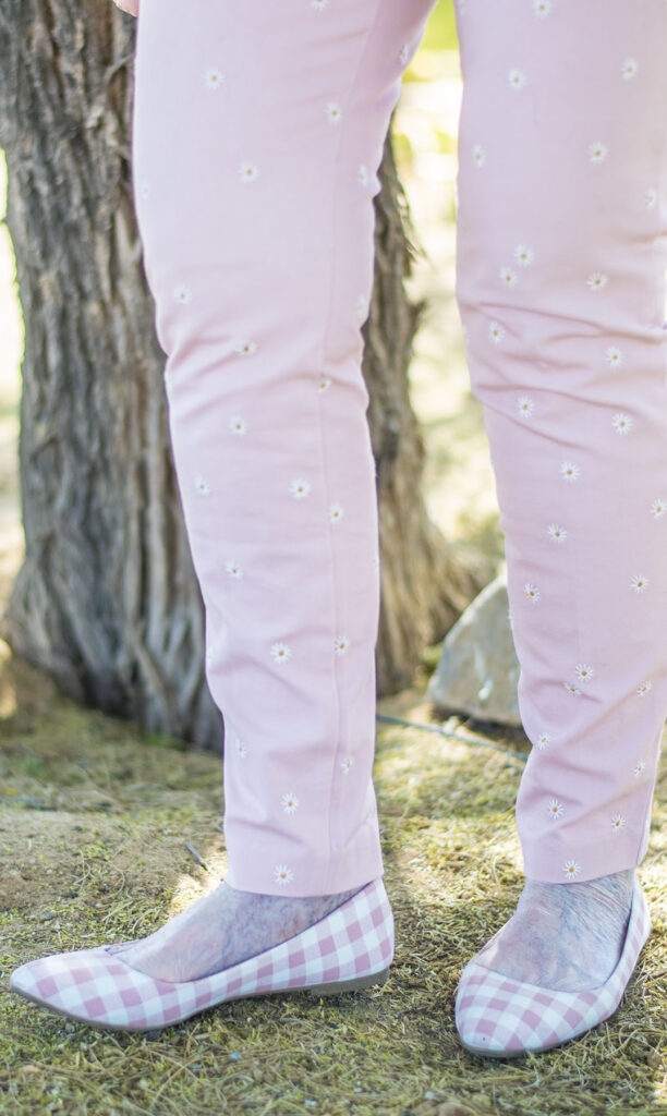 Pink embroidered jeans and pink flats