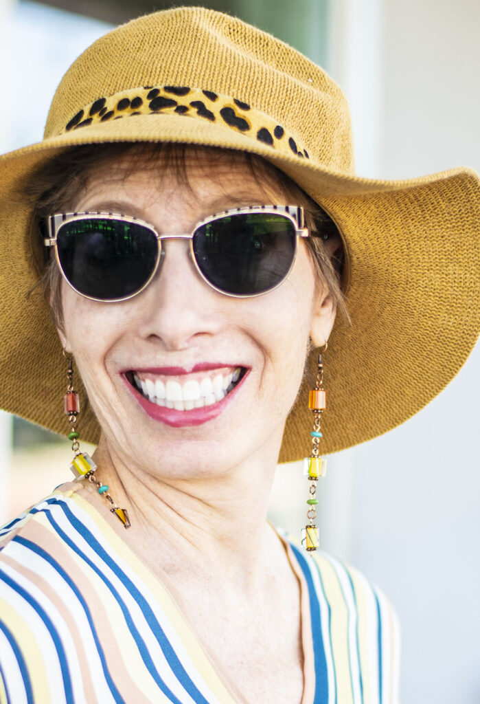 Summer hat and shoulder scraping earrings