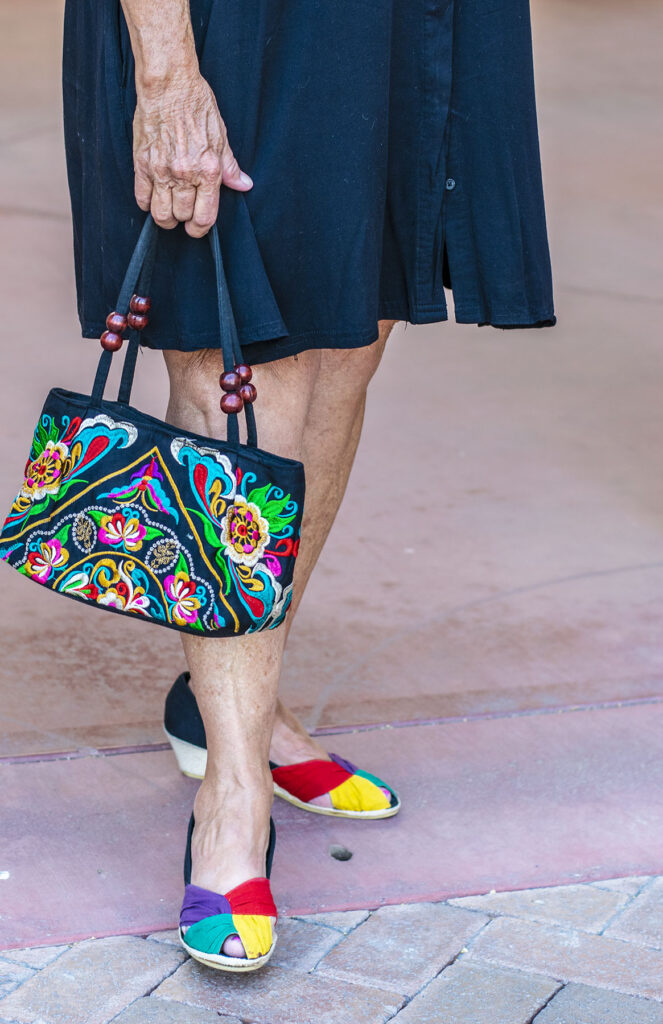 How to add color to an outfit with shoes and a purse