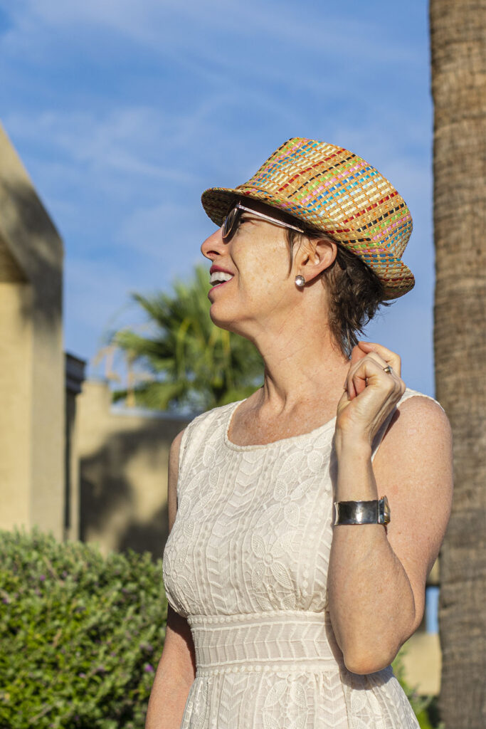 Keep accessories minimal when you style a hat