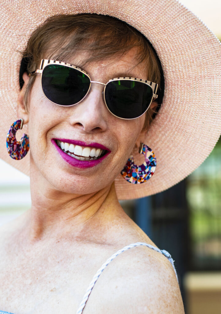 Colorful earrings and lipstick