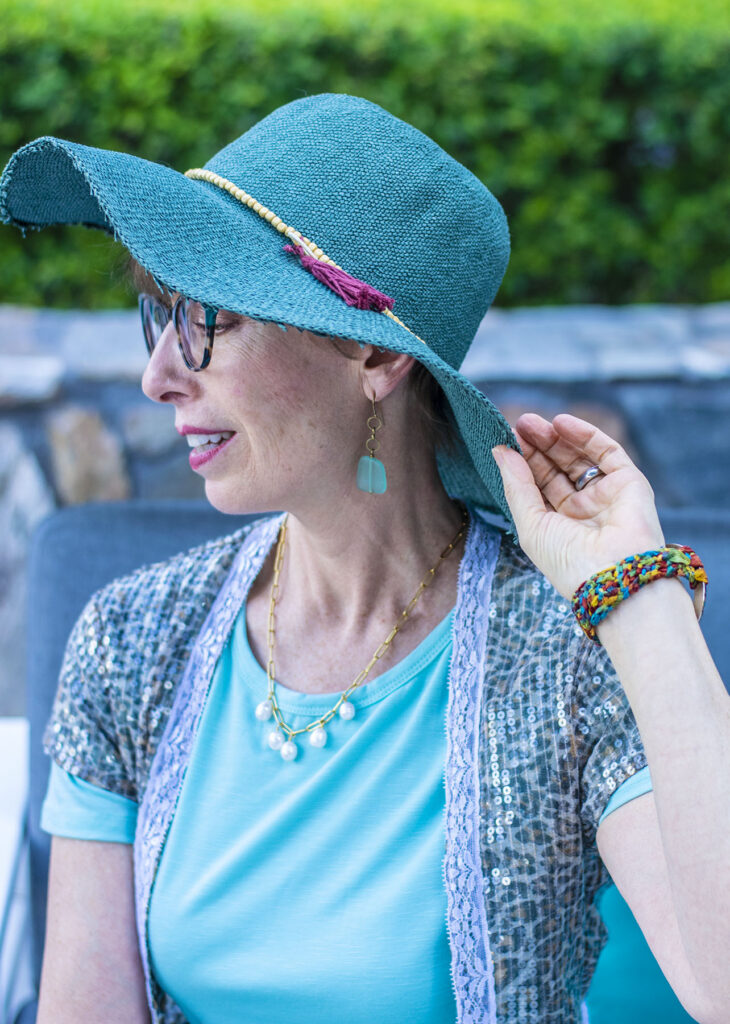 Hat and pearls on how to dress up a casual dress