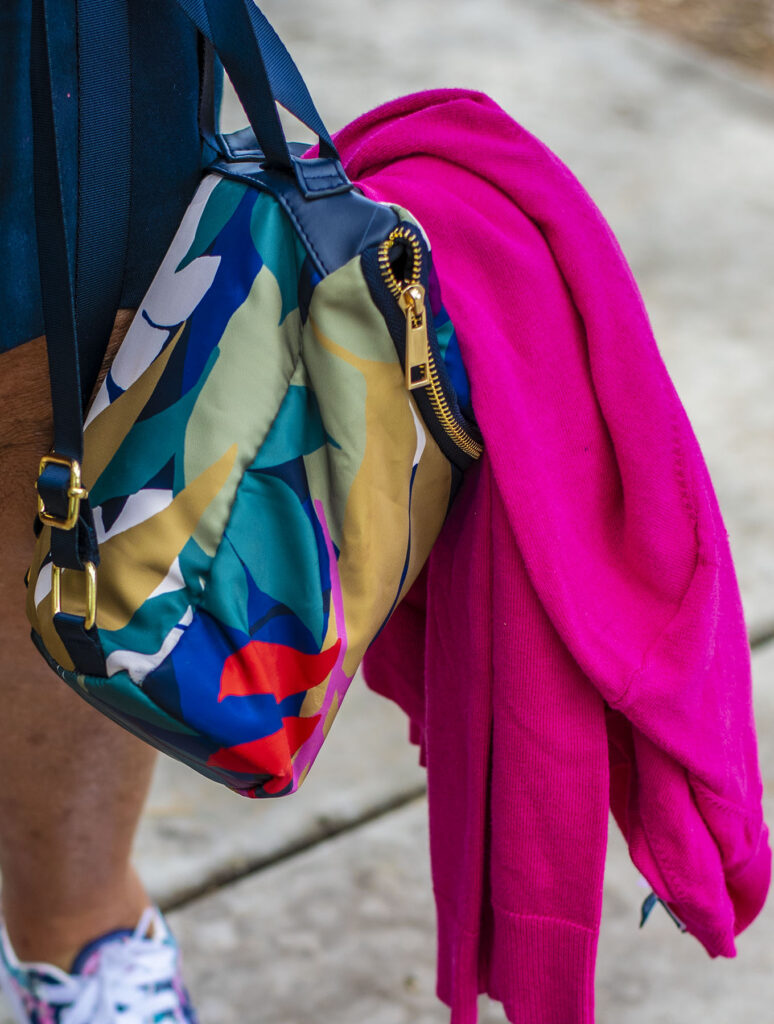 Colorful backpack and cardigan