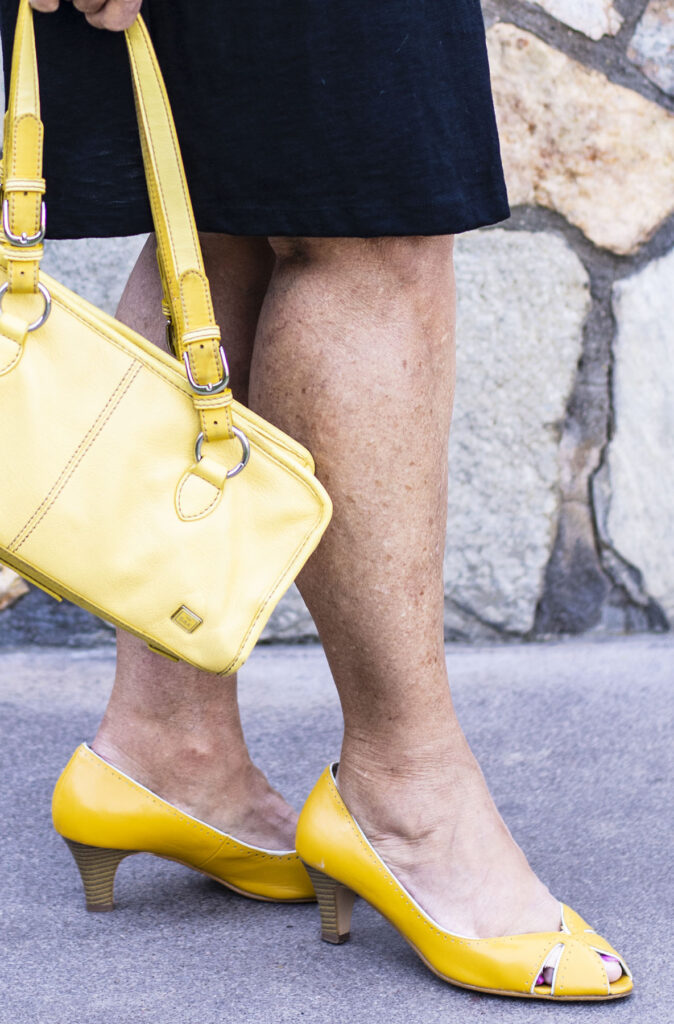 Yellow heels and purse