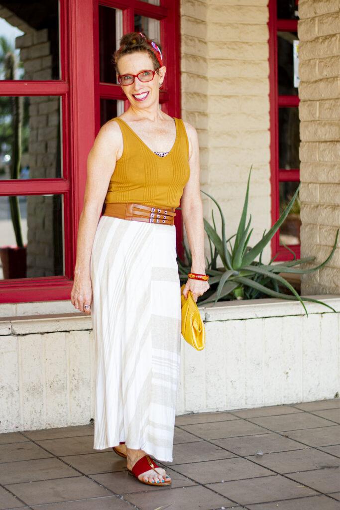 Wear a maxi skirt over your dress