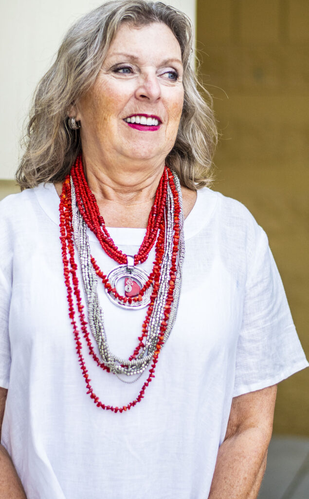 Red and silver layered necklaces