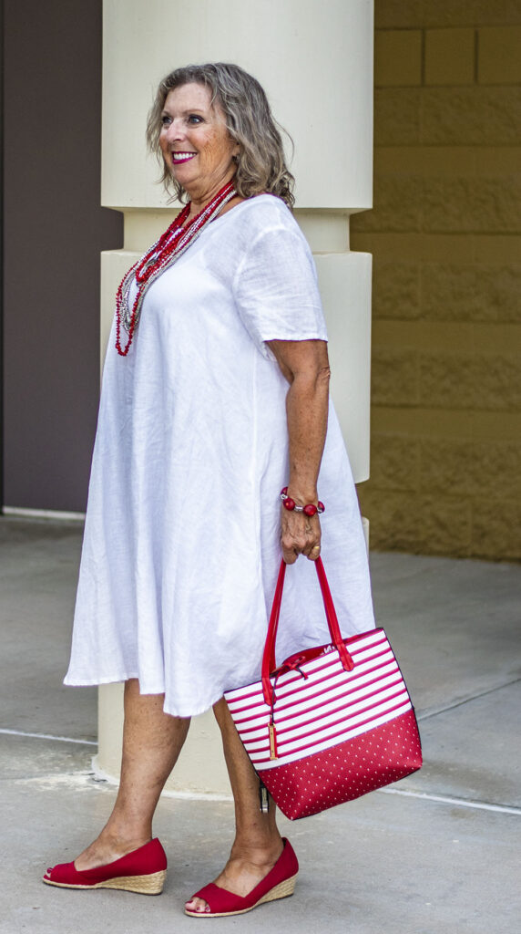 Adding red to a white linen dress