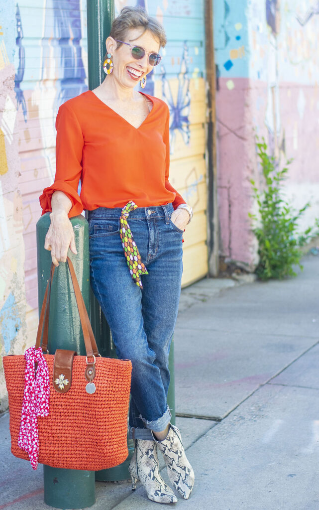 Fall colors wearing ankle boots with jeans